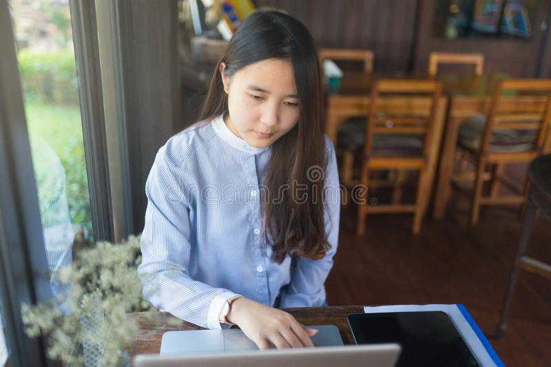 Smart women using laptop and smartphone and technology stock images