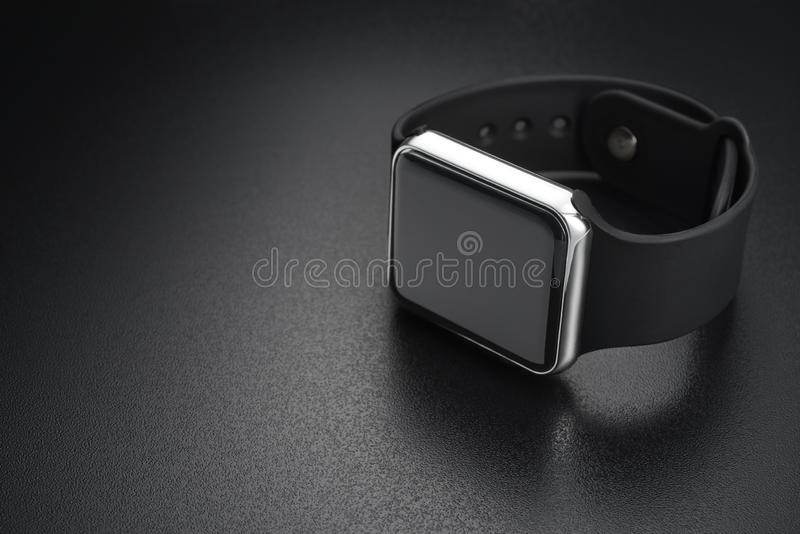 Smart wrist watches on black stock photography