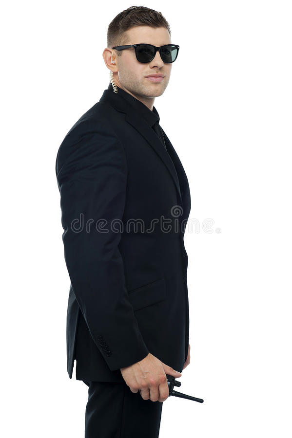 Smart young confident security officer posing stock photo
