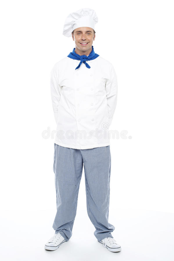 Smart young smiling male chef posing casually royalty free stock photos