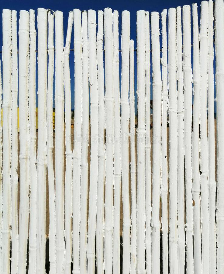 Background of white sticks with a skylight to the background stock photography