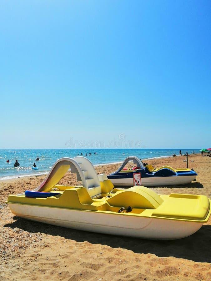 Beach transport. yellow catamaran on the sand stock images