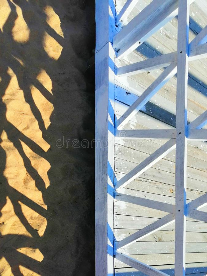 Geometric shapes of architecture against the sand stock image
