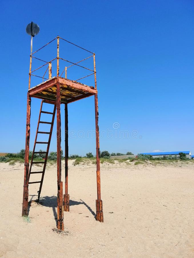Old iron tower on the sand stock photo