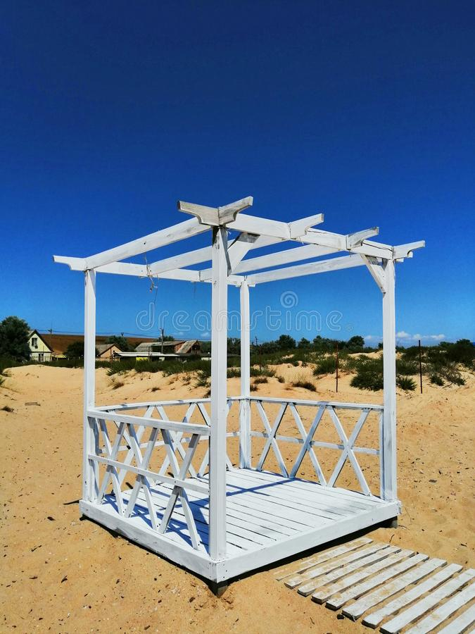 Pergola for rest on the sand stock image