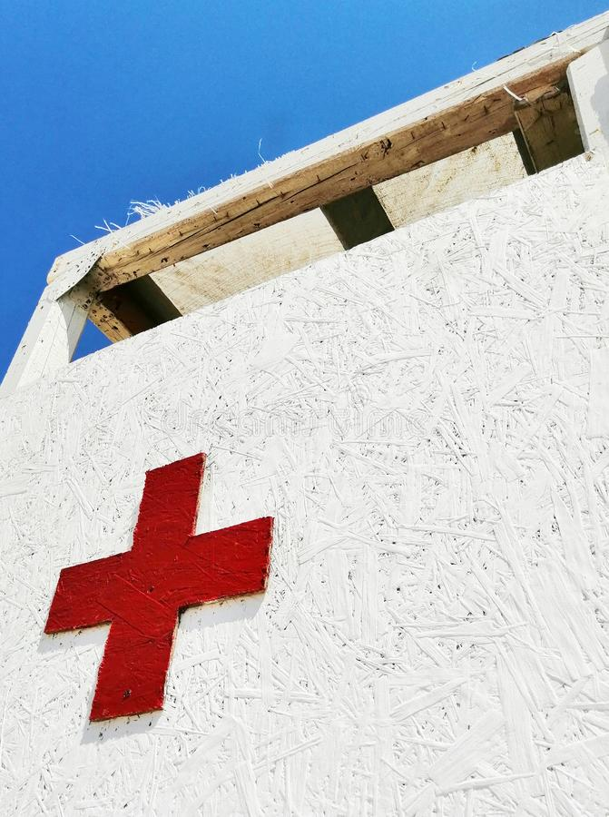 Red cross on a white background royalty free stock photo