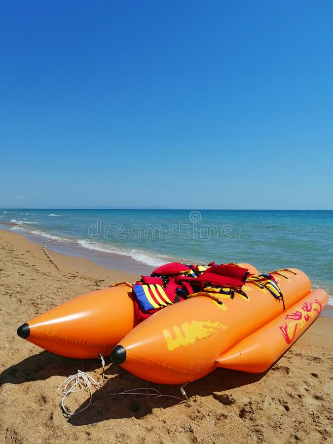 Sea attraction. inflatable banana boat on the beach stock images