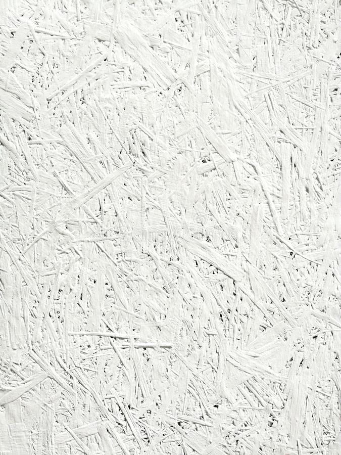White background. uneven texture of white shavings royalty free stock photography