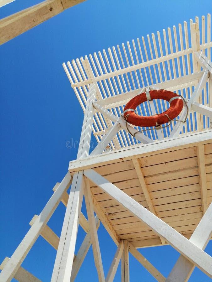 White rescue tower on the coast royalty free stock photos