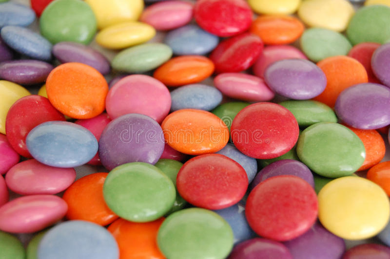 Smarties Background. A colourful background filled with smarties stock image