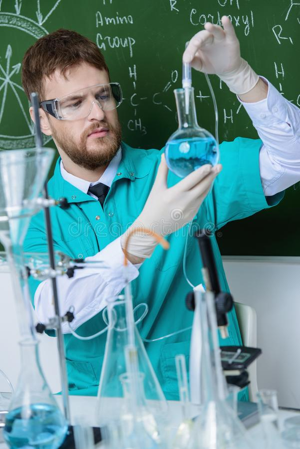 Conduct chemical experiments. Smartman scientist making chemical experiments in the laboratory. Educational concept. Discovery stock image