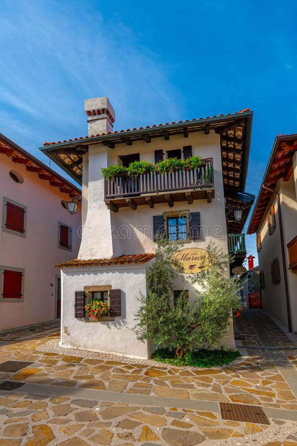 Hisa Marica on Main Square in Historic medieval town of Smartno in Goriska Brda, Slovenia with narrov streets leading. Smartno, Slovenia - Aug 15 2018: Hisa royalty free stock photos