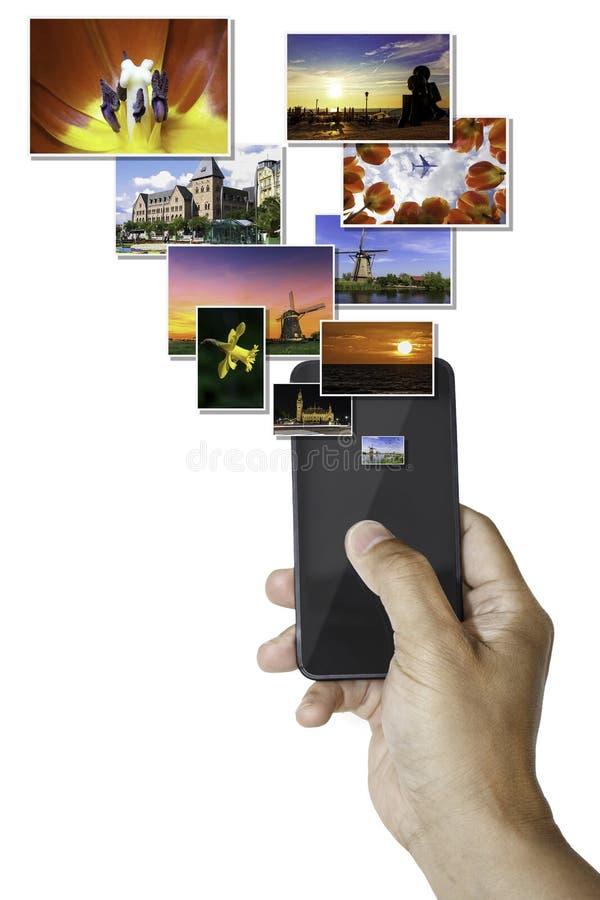 Smartphone που στέλνει τις εικόνες στοκ φωτογραφία με δικαίωμα ελεύθερης χρήσης