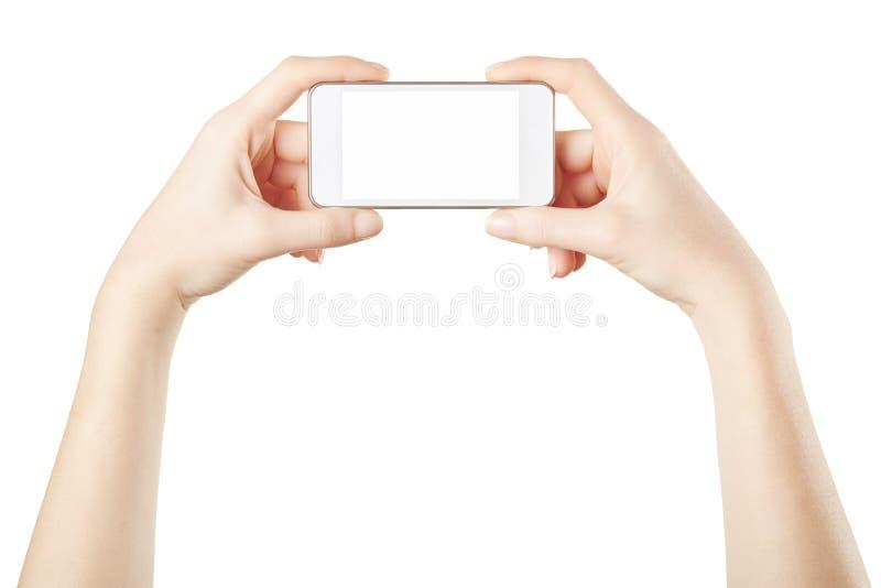Smartphone στα θηλυκά χέρια που παίρνουν τη φωτογραφία στοκ εικόνα με δικαίωμα ελεύθερης χρήσης