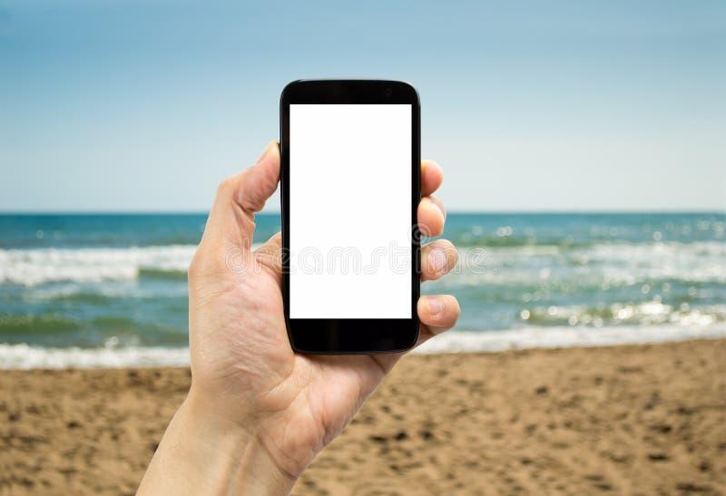 Smartphone στην παραλία στοκ εικόνα