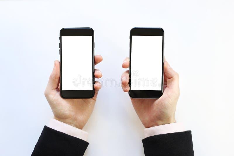 Smartphone в руке стоковые фотографии rf