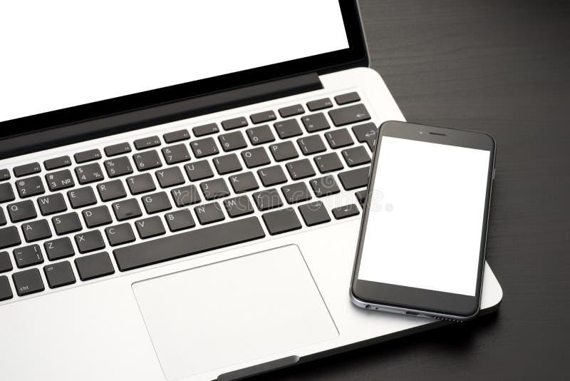 smartphone компьтер-книжки стоковые фото
