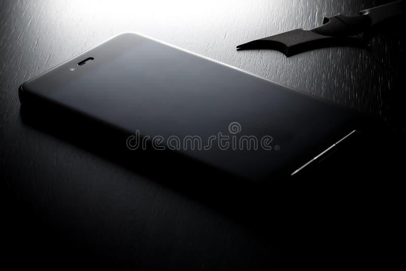 Μαύρο αρρενωπό Smartphone στοκ εικόνες