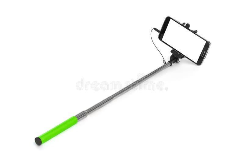 Smartphone avec le bâton de selfie photographie stock libre de droits
