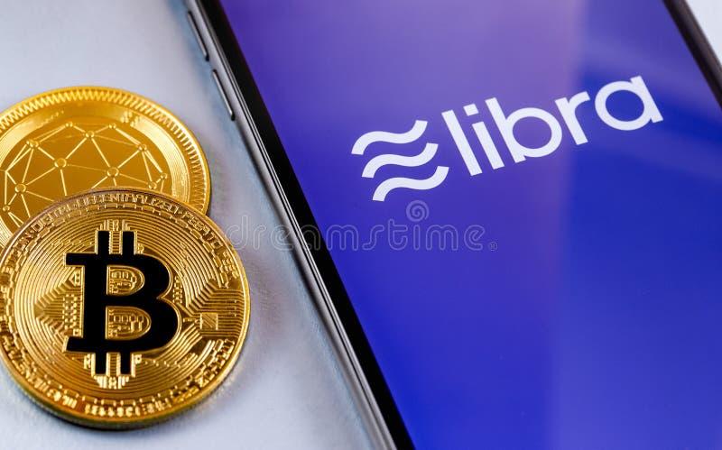 Smartphone avec logo de Libra Facebook photos stock