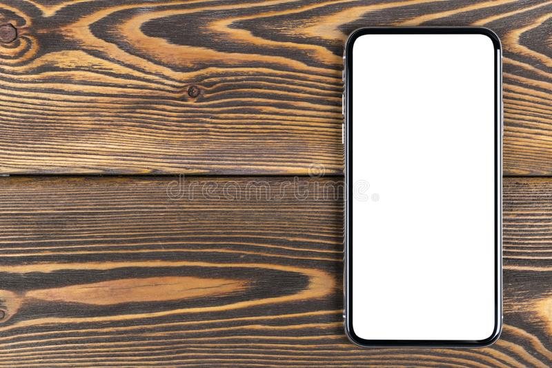 Smartphone with blank screen mock up. Smartphone isolated screen with clipping path. Mobile phone white screen with copy space on stock photos
