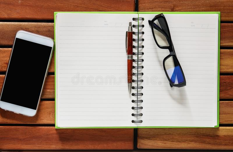 Smartphone , Book with pencil and glasses royalty free stock photos