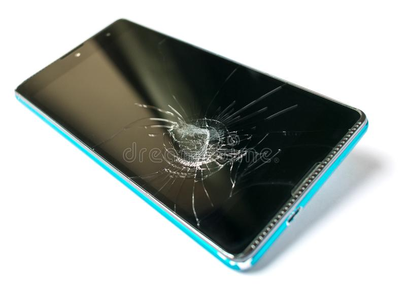 Smartphone with a broken screen isolated on white background. Phone repair concept closeup. royalty free stock images