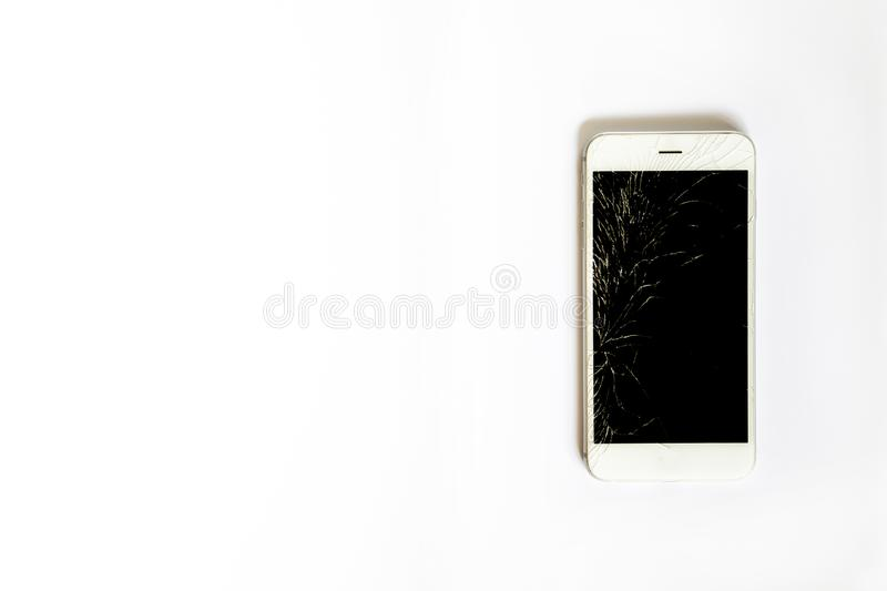 Smartphone with broken screen on white background stock photo