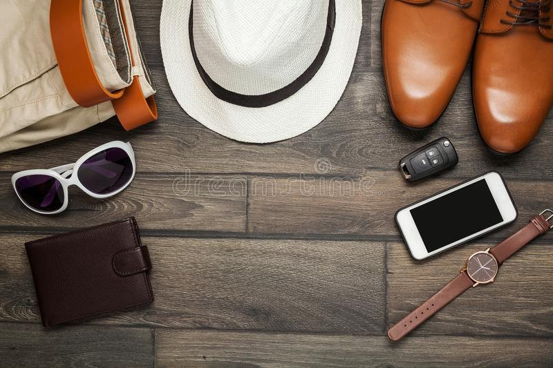 Smartphone, brown shoes, Trousers and royalty free stock photo