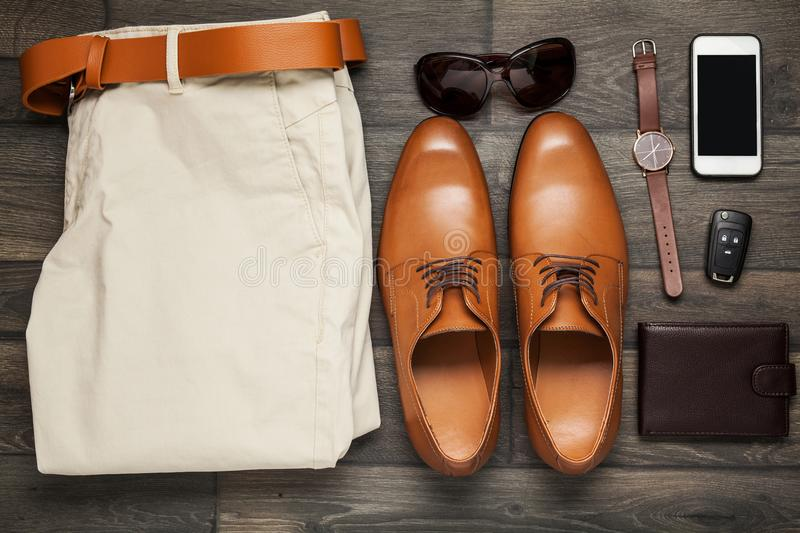 Smartphone, brown shoes, Trousers and stock photography