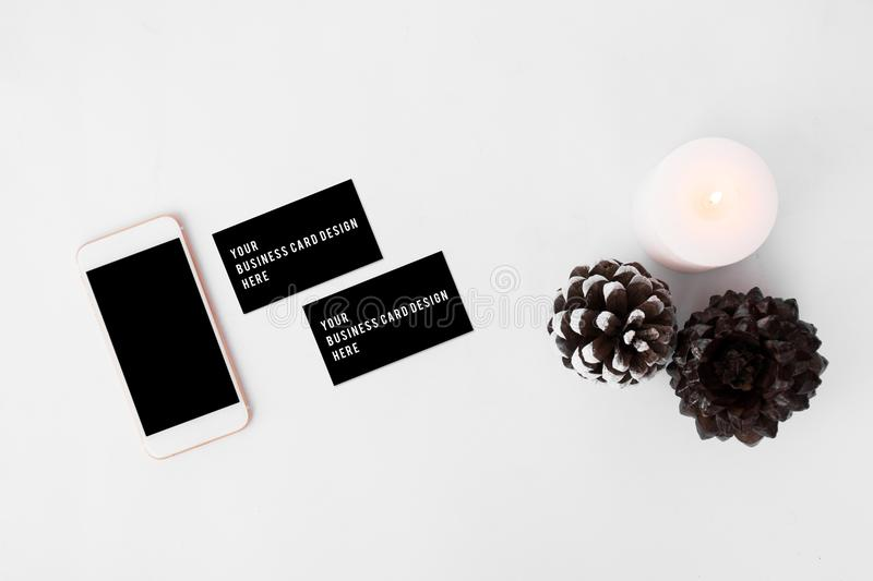 Smartphone business cards christmas composition stylish arrangement download smartphone business cards christmas composition stylish arrangement of cones and candle on white background colourmoves Choice Image