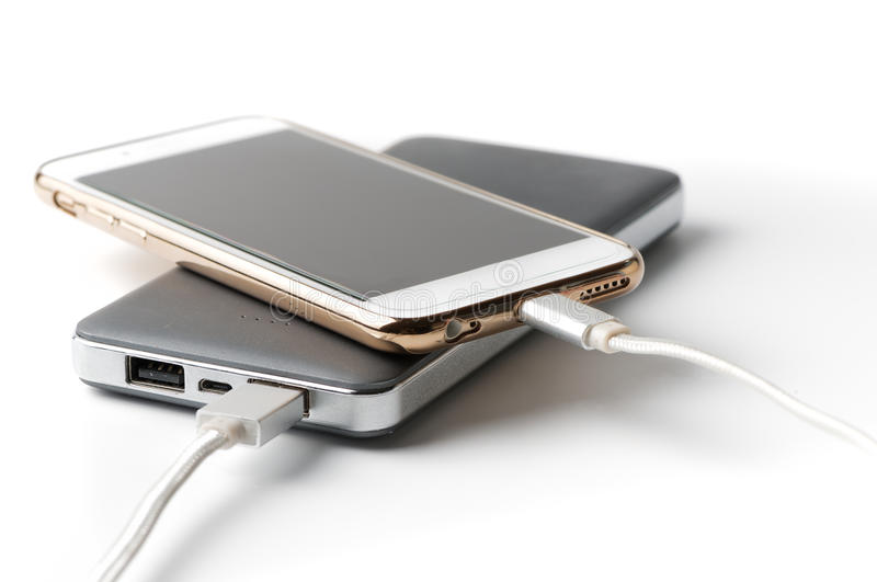 Smartphone charging with power bank royalty free stock image