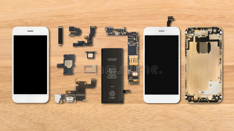 Smartphone components on wooden background. Flat Lay Top view of smartphone components on wooden background royalty free stock photo