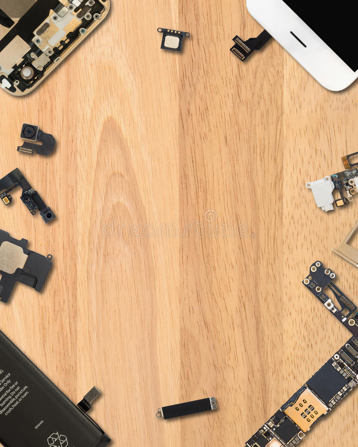Smartphone components on wooden background. Flat Lay Top view of smartphone components on wooden background with copy space in 4:5 aspect ratio stock photography