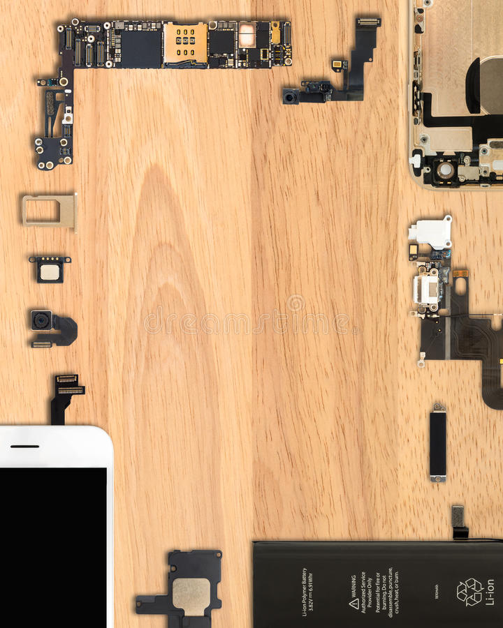 Smartphone components on wooden background. Flat Lay Top view of smartphone components on wooden background with copy space in 4:5 aspect ratio royalty free stock images