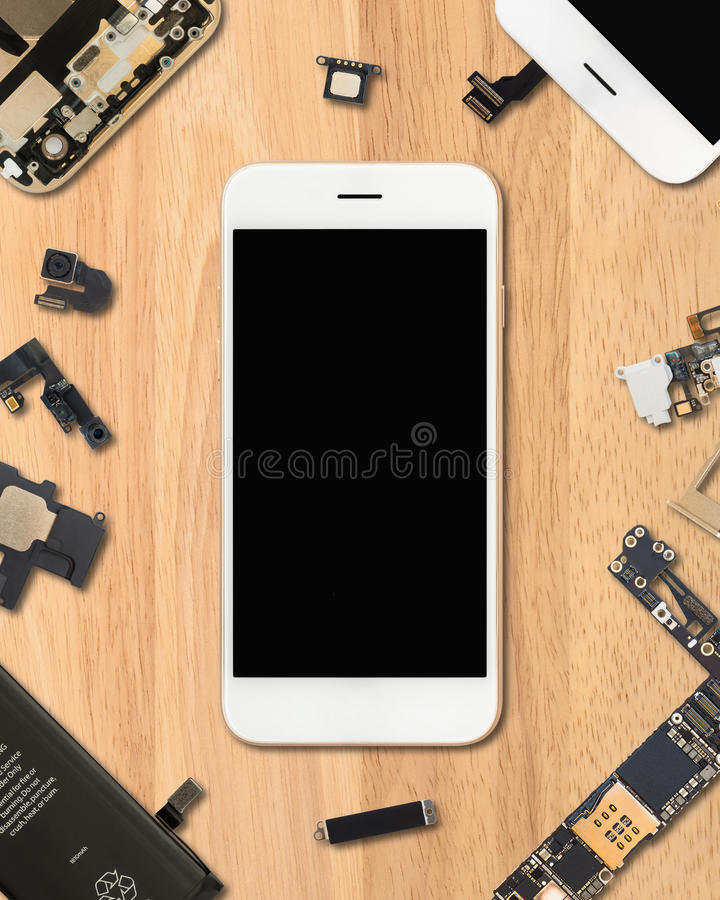 Smartphone components on wooden background. Flat Lay Top view of smartphone is surrounded by its own components on wooden background in 4:5 aspect ratio stock photography