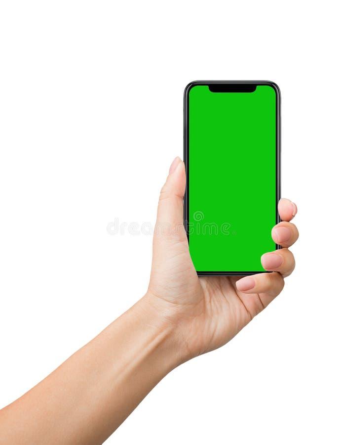 Smartphone con la pantalla verde para la maqueta dominante de la croma fotos de archivo libres de regalías