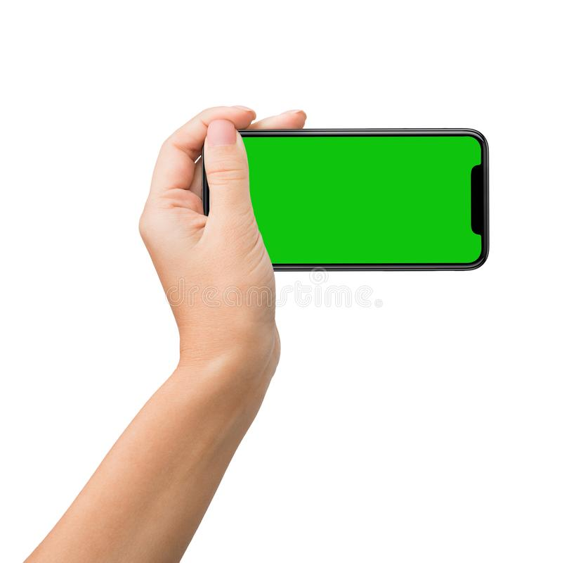 Smartphone con la pantalla verde para la maqueta dominante de la croma imágenes de archivo libres de regalías