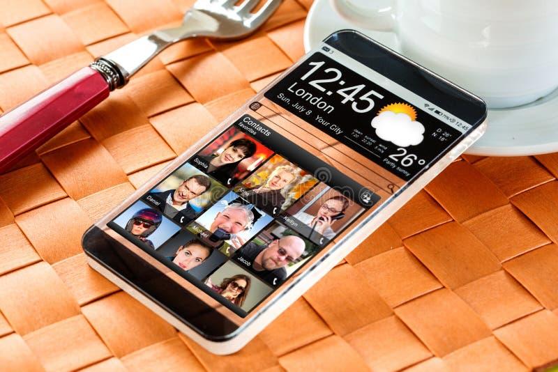 Smartphone con una exhibición transparente imagen de archivo
