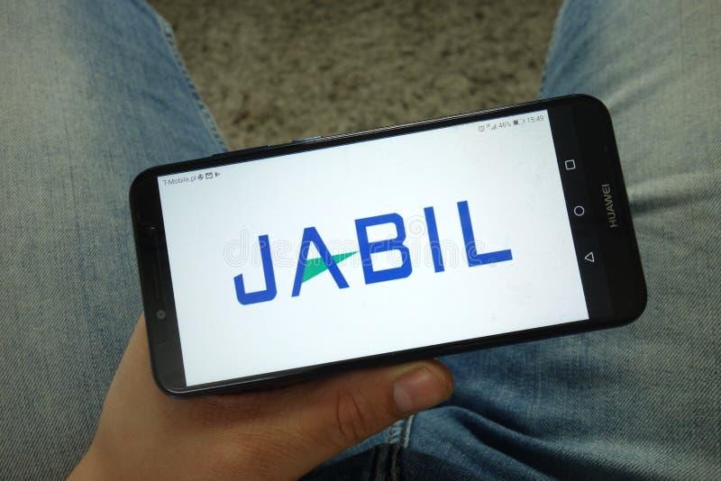 Smartphone da terra arrendada do homem com Jabil Inc logo imagem de stock royalty free