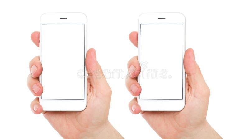 Smartphone dans des mains masculines Écran d'isolement pour la maquette Position isométrique bilatérale, l'espace de copie images stock