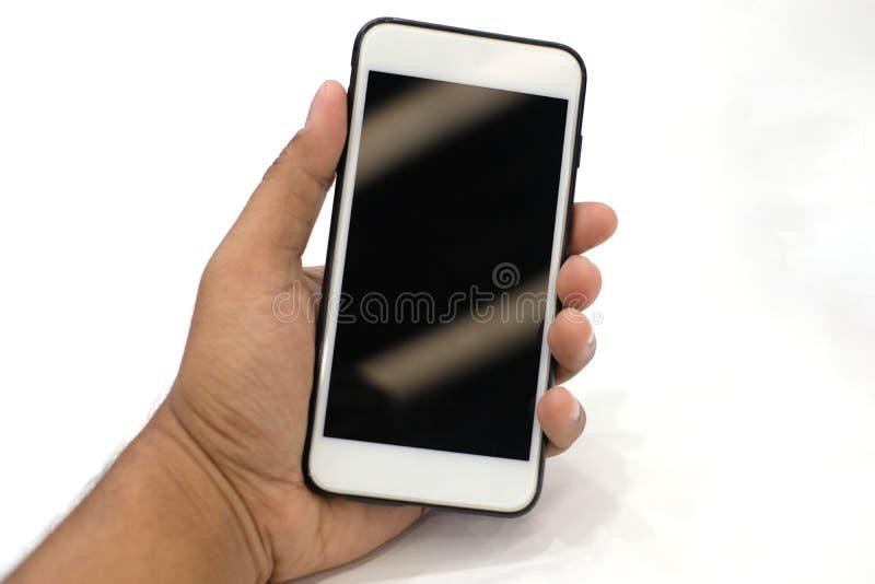 Smartphone de la tenencia de la mano o teléfono móvil imágenes de archivo libres de regalías