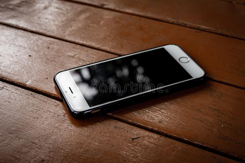 Smartphone with dirty screen on brown wooden table stock images