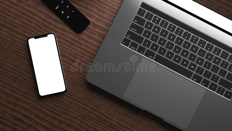 Smartphone e port?til em uma tabela de madeira imagens de stock