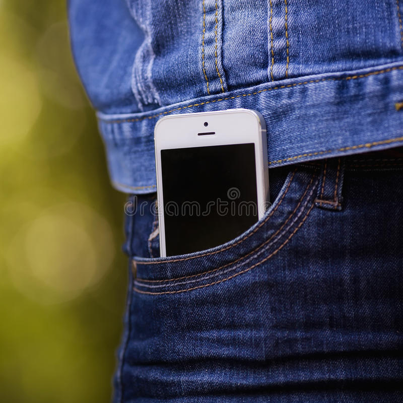 Smartphone in everyday life. phone in jeans pocket. stock image