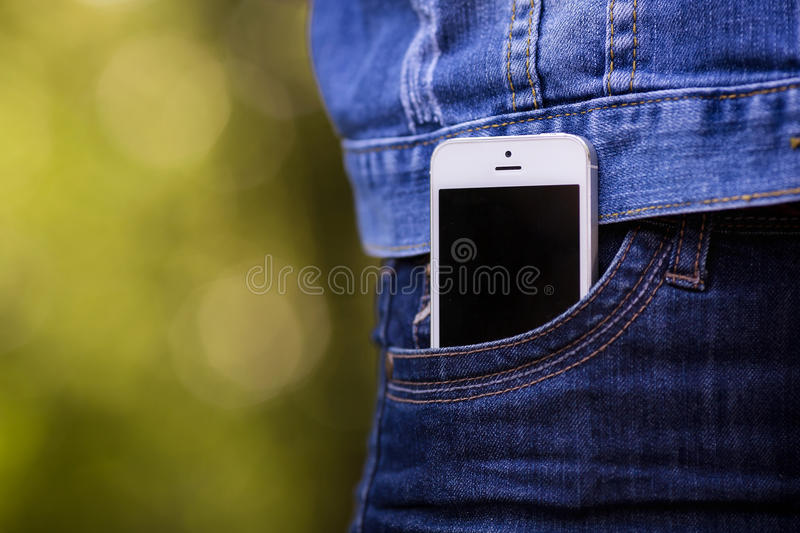 Smartphone in everyday life. phone in jeans pocket. stock photos