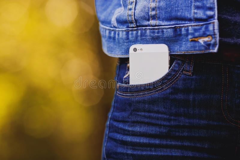 Smartphone in everyday life. phone in jeans pocket. stock images