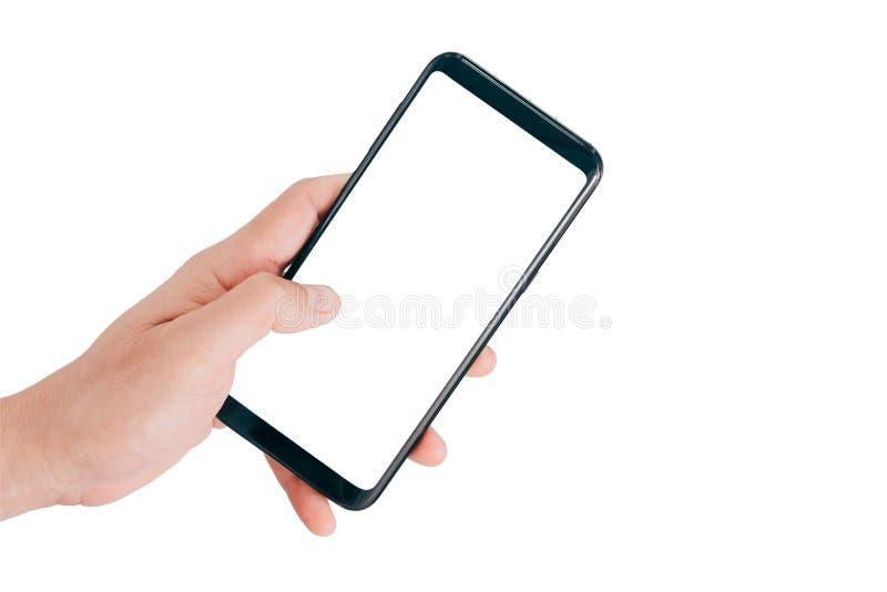 Smartphone förlöjligar upp, den hållande mobiltelefonen för hand och att använda den rörande skärmen som isoleras på vit bakgrund fotografering för bildbyråer