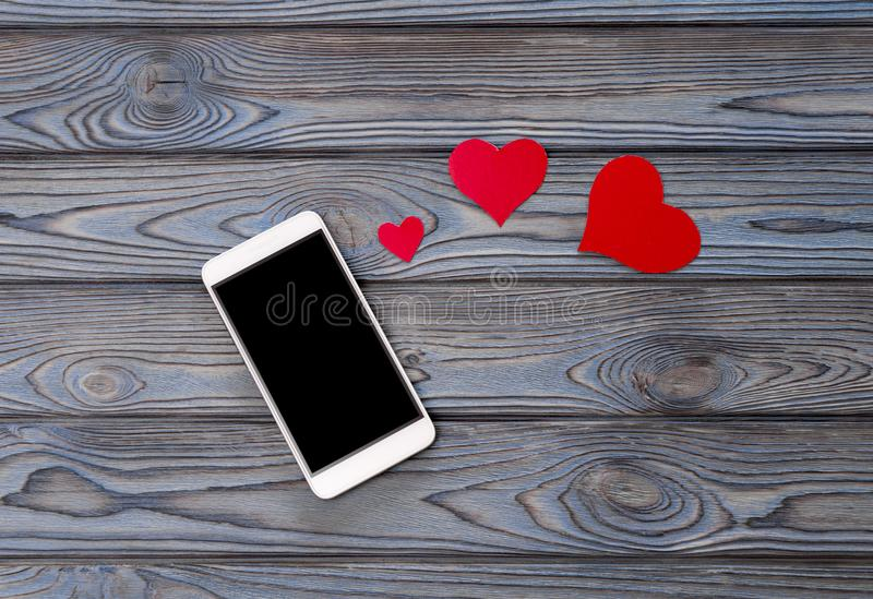 Smartphone, figures of hearts. love. relations royalty free stock photo