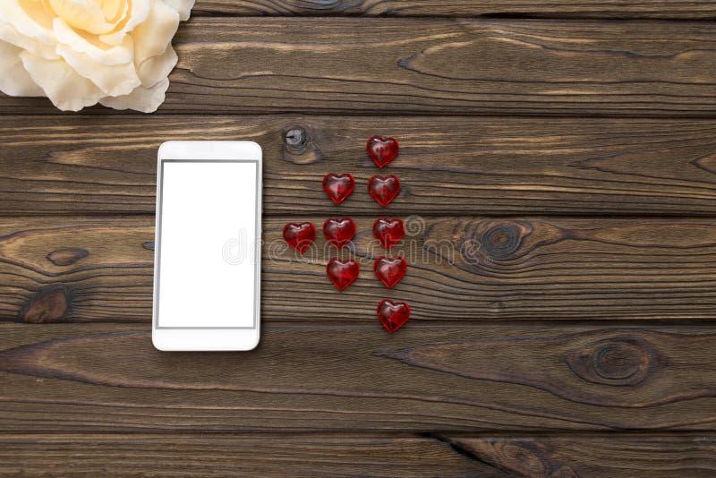 Smartphone, flor, figuras del heartsи fotografía de archivo libre de regalías